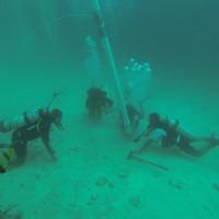 Underwater excavation in the Farasan Islands, offshore of Qumah, showing use of airlift with Faris Hamzi, Abdullah Al Haiti, Jumah Al Sadiq and Christin Mason (Photo: Garry Momber: 2014).